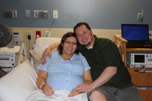 Julie and Ryan on a hospital bed