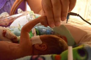 Grant holding Julie's finger