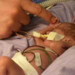 Hazel holding Ryan's finger