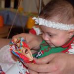Hazel opening a gift