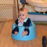Grant sitting in a Bumbo