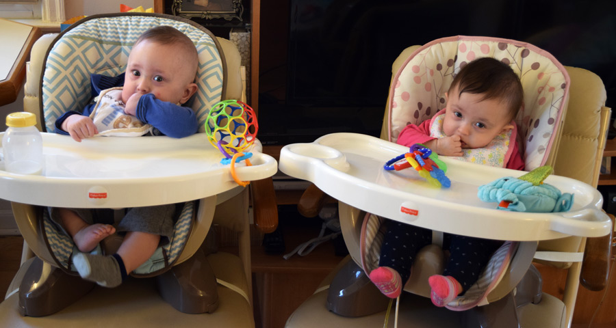 Hazel and Grant in their high chairs