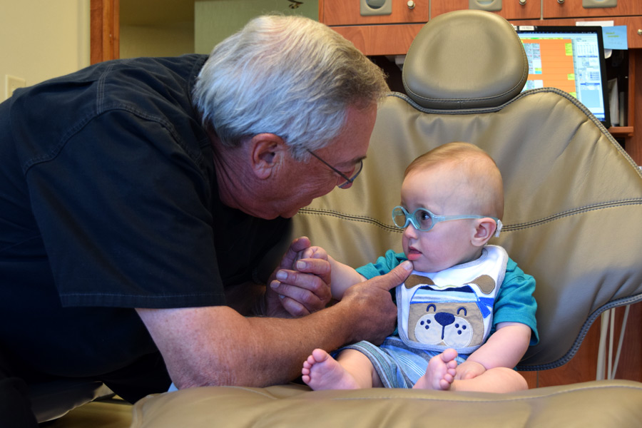 Grant getting his first dental checkup from Grandpa.