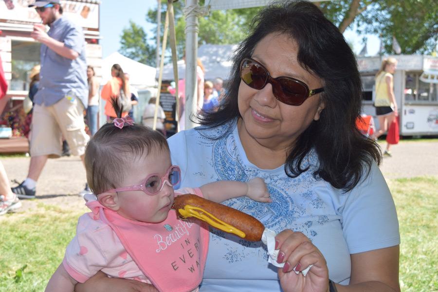 Hazel trying a corn dog